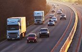 stock photo of travel trailer  - Highway with a many cars and Truck - JPG