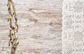 Easter Decoration With Catkins And Lace Cloth On Old Wood