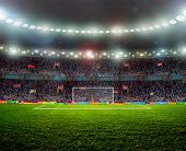 stock photo of grass area  - Soccer ball on the field of stadium with light - JPG