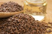 picture of flax seed oil  - Linseed oil and flax seeds on wooden background - JPG