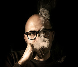 image of male pattern baldness  - Man holding cigarette and smokinglow key technique - JPG