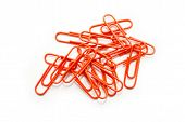 Bright Orange Paperclips Scattered On A White Background