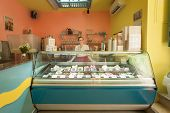 DUBROVNIK, CROATIA - MAY 26, 2014: Dolca vita ice cream parlour with friendly waitress