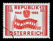 AUSTRIA - CIRCA 1955: a stamp printed in the Austria shows Letters forming Flag, 10th Anniversary of
