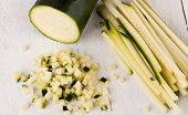 stock photo of marrow  - Fresh marrow or courgette cut into batons and diced into small cubes for use in salads and as a vegetable in cooking - JPG