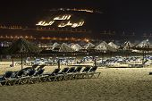 AGADIR, MOROCCO - AUGUST 25: Beautiful beach by night on 25 August 2014 in Agadir, Morocco. Kasbah mountain in the background with inscription: Allah , The King , One's native land.