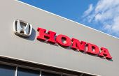 Samara, Russia - August 30, 2014: Honda Dealership Sign Against Blue Sky. Honda Motor Co., Ltd. Is A