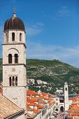 View on Franciscan Monastery tower and Bell tower from old city walls. These towers are very popular landmarks on Stradun, main pedestrian street in Dubrovnik.