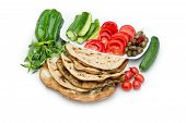 Lebanese food of Cheese and thyme manouche with veggies isolated