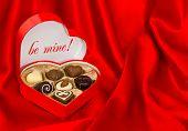 Chocolate Pralines In Heart Shape Box. Valentine Gift
