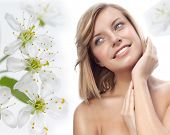portrait of attractive  caucasian smiling woman blond isolated on white studio shot  lips toothy smile face hair head and shoulders closeup hands flowers aroma spring
