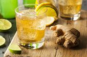 stock photo of ginger  - Organic Ginger Ale Soda in a Glass with Lemon and Lime - JPG