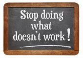 stop doing what does not work  advice on a vintage slate blackboard