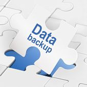 Data Backup On White Puzzle Pieces