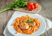 foto of meatballs  - Chicken Meatballs With Pasta On The Wooden Table - JPG