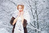 Fashion woman in winter forest