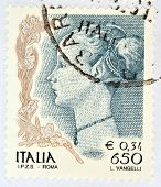 ITALY - CIRCA 1998: A stamp printed in Italy shows portrait of Woman by Antonio di Jacopo Pollaiuolo