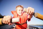 foto of life-boat  - Boy rowing a boat on a lake - JPG