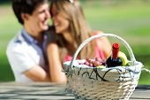 Attractive Couple On Romantic Picnic In Countryside.