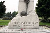 stock photo of tribute  - A world war memorial made of stone stands proudly in the park of Smiths Falls Ontario - JPG