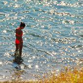 Girl In Sunny Sea Water