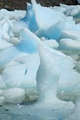 Closeup of small blue and white icebergs floating in lake, Torres del Paine, Chile.