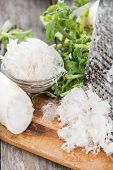 image of grated radish  - Fresh grated Horseradish on dark wooden background - JPG