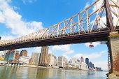 Queensboro Bridge and Roosevelt Island Tramway with view on Manhattan New York.
