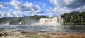 foto of canaima  - powerful waterfall and a lake in canaima in vanezuela - JPG