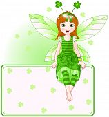 Little cute fairy sitting on place card for St. Patrick Day