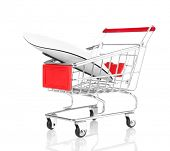 Small shopping cart with computer mouse isolated on white
