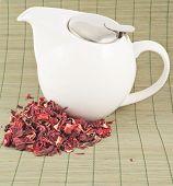 White teapot with red tea
