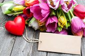 pic of bouquet  - Bouquet of tulips with an empty tag and red heart on wooden background - JPG