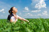 girl in suit resting in a field