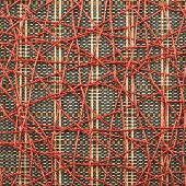 Bamboo mat covered with red thread