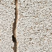 Cracked cement wall fragment