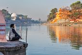 UJJAIN, INDIA - APRIL 25, 2011: Man meditating in the morning on ghats of holy Kshipra river. Shipra is one of the sacred rivers in Hinduism