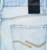 Denim jeans back pocket fragment