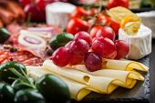 stock photo of catering  - Antipasto and catering platter with different appetizers - JPG