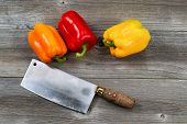 Bell Peppers And Knife On Age Wood