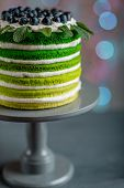 picture of cake stand  - Nice sponge happy birthday cake with mascarpone and grapes on the cake stand on festive light bokeh - JPG