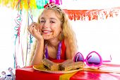 happy party girl with presents eating chocolate in birthday dirty mouth
