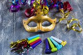 Carnival Mask With Colorful Streamers And Party Blowers