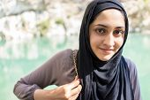Arabic Muslim Middle Eastern girl on the river