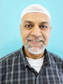 stock photo of pakistani  - Senior Arabic Pakistani man studio portrait - JPG