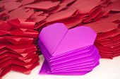 Stacks Of Pink And Red Paper Hearts For Valentine's Day