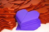 Lots Of Orange And Blue Purple Paper Hearts For Valentine's Day