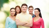 friendship, ecology and people concept - group of smiling teenagers standing over green background