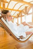 Woman relaxing on wellness spa lounger