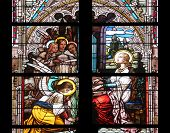 VIENNA, AUSTRIA - OCTOBER 11: Saint Cecilia, stained glass in Minoriten kirche in Vienna, Austria on October 11, 2014.